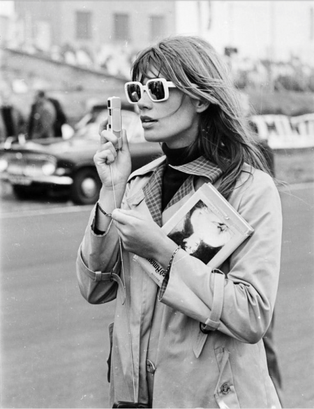 French singer, actress and fashion muse, Françoise Hardy, looking like a retro fashion detective on the streets of paris in the 1960s.