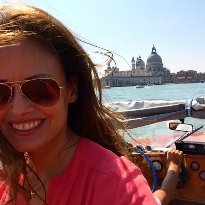 In the water taxi on my way into the city. even the taxi rides are chic in Venice!