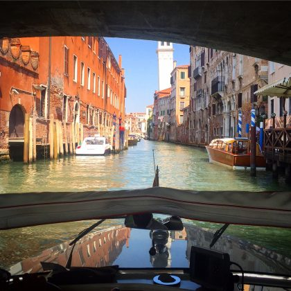 In what other city do you get to buzz around on retro wooden boats, on water canals, feeling like James Bond?